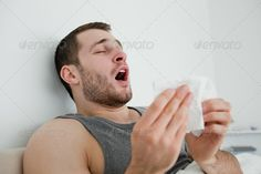 Sick man sneezing ...  18-19 years, Caucasian appearance, One Person, Young Men, allergy, bacteria, beautiful, bed, bedroom, blow, blowing, care, cold, cuff, disease, face, fever, flu, hand, handkerchief, health, healthcare, home, hurt, ill, illness, infection, influenza, medical, medicine, nose, pain, patient, sick, sickness, sneeze, sore, suffer, symptom, tissue, treatment, virus, winter
