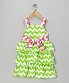 This tiered ruffle dress brings contemporary charm to any cutie's closet by combining timeless smocking with vibrant colors. Handmade from crisp cotton, it's sure to last through loads of play and pulls on easily thanks to the buttons in back.