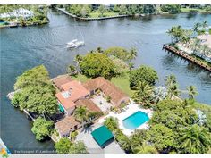 First time offered to market!One of Fort Lauderdale's last original significant trophy points. Enjoy 36,626 sf (.84 acre), +/-616 ft of waterfrontage on 3 sides offering Dockage for up to 180ft or multiple yachts. Superbly located on extremely private Mola Avenue where old South Florida ambiance is blending with some of the finest new multi-million dollar residences. Incredible views from many rooms. Pointe of Palms has potential for renovation or tear down to