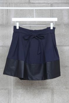 Navy tie waist skirt with faux leather bottom