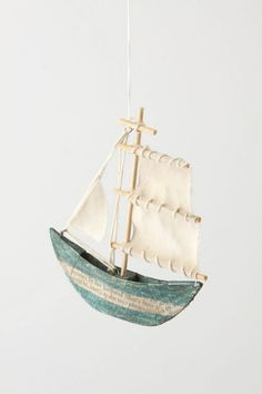 Sea Story Sailboat Ornament from Anthropologie.  This looks easy enough - simple paper mache.  Then just add some yarn, canvas, thin dowel rods, and a couple of eye hooks.  Oh, and I'd use wood glue to hold the sticks together.