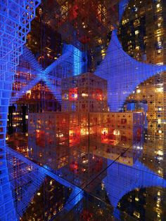 """French artist Serge Salat invites visitors to take a journey through endless layers of space, decked out with cubic shapes, panels of mirrors, shifting lights and music. """"Beyond Infinity"""" is a multi-sensory, multimedia experience that blends Eastern Chinese with Western Renaissance."""