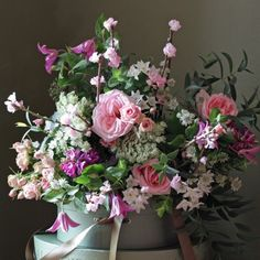 The Real Flower Company Spring Pastle Pink & Ivory Bouquet   http://www.realflowers.co.uk/valentines-flowers-1/spring-pastel-pink-rose-blossom-bouquet.html