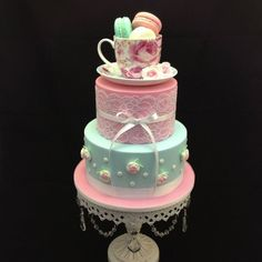 Two tier Kitchen Tea cake topped with a pretty cup and saucer filled with yummy macarons