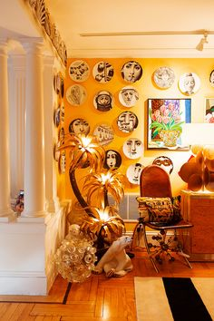 Creative wall design with plates and art.