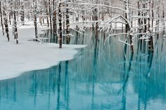 Blue Pond & Spring Snow, Hokkaido, Japan. Surprisingly, the blue of the water has no exact explanation, but this blue pond can change colors depending on the time of day. Tourists come from around the world to see this.