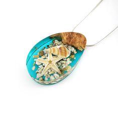 Absolutely love this Pendant! Aquarium Seashell Starfish Terrarium Pendant Necklace Handmade from Live Edge Burl Wood and Blue Epoxy Resin, Mermaid Jewelry Collier Femme Handmade Necklaces, Handmade Jewelry, Handmade Gifts, Etsy Handmade, Unique Gifts, Handmade Items, Sea Glass Jewelry, Resin Jewelry, Jewellery