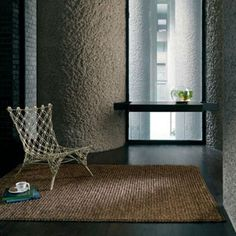 This environmentally friendly 'Jute' rug comes in a natural colour with a woven design which will fit perfectly into any room. It has been spun into coarse, strong threads, which means it is perfect for floor rugs as is hard-wearing and durable.