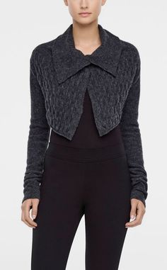 This crop-style cardigan's wool blend features elasticity for a snug, season-ready fit. Snap buttons hold everything together. Wear the cardigan with a long dress.