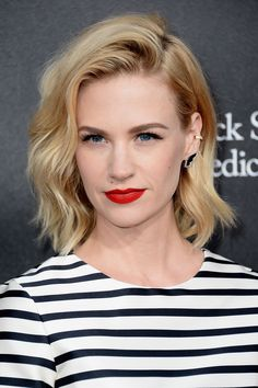 January Jones. If her hair was a little longer, my hair would look just like hers once cut: the waviness, and the deep side part just like mine!