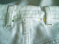 Take in jeans at the side seam. Mmm, not crazy about the added side waist seam.....