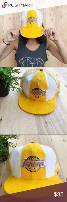 LA Lakers vintage SnapBack trucker hat Vintage yellow and purple LA Lakers snap back trucker hat. Has flat bill. Bill has been bent in some places due to vintage wear but it doesn't stop this hat from being supa cute! Vintage Accessories Hats