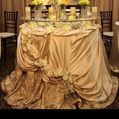 Headtable. Beautiful tablecloth. I also love how the glass separates the décor so it can still be use for dinner
