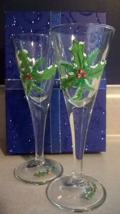 Holly leaves hand painted on stemmed shot glasses.