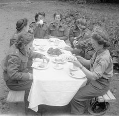 BRITISH ARMY NORMANDY 1944 (B 5813)   Women of Queen Alexandra's Imperial Military Nursing Service (QAIMS) eating in the open at No 79 General Hospital near Bayeux, 20 June 1944.