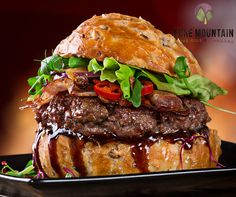 King Kong Burgers | Pure Mountain Olive Oil and Vinegars | www.PureMountainOliveOil.com |   These burgers are serious. Made from ground sirloin, we mixed some thick, sweet balsamic vinegar into the patties and found an amazing new dinner. We topped it with smoked gouda, lettuce, tomato, and bacon. | #extravirginoliveoil #balsamicvinegar #burgerrecipe #healthyburger #brioche #gouda #cheeseburger