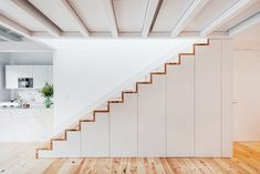 Pedro Ferreira Architecture Studio has converted an abandoned house in Porto, Portugal into six flats with pine, white marble and concrete. Staircase Storage, Stair Storage, Stairs With Storage, Stairs Architecture, Interior Architecture, Interior Design, Cabinet Under Stairs, Bike Storage Home, Storage Room