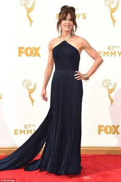 The dark side: Felicity Huffman looked like she was having a ball in her new brunette tresses at the Emmys on Sunday