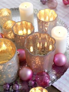 silver and pink-toned grouping of votives and ornaments