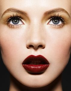 Oxblood lip colour {via weddingsplannersmanagers.wordpress.com} - see more on http://themerrybride.org/2014/05/03/oxblood-red-wedding/