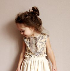 Little girl style... Her hair is so sweet!