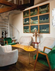 This room is the epitome of laidback cool with the addition of some funky furniture in rich hues, like these green chairs, and a set of architectural paintings #bold #detail #LesTroisGarcons