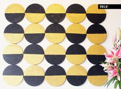 In this tutorial, 20 trivets were masked, painted, and nailed to the wall to create a graphic wall element. While it's stylish enough to stand on its own (I can see this in white and gold, or even neon with bare cork), it works even better in a studio or office as a bulletin board for pinning photos and inspiration.