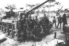 """Cuban soldiers pose in front of a captured South African """"Elephant"""" MBT. Photo taken near the river Cuito sometime during Apartheid, Super Images, History Online, African Elephant, African History, War Machine, Special Forces, Cold War, Armed Forces"""