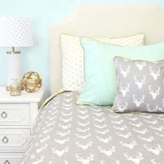 This gray and white deer print is perfect for any big boy's room! The antlers…