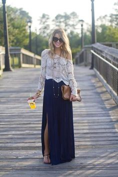 Boho Look: White crochet top with navy, thigh high slit skirt, brown clutch and long necklace.