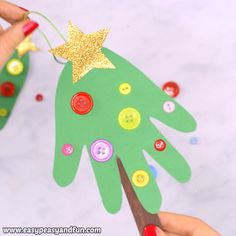 This handprint Christmas tree craft makes a wonderful ornament for your tree and a keepsake to treasure for years to come. This handprint Christmas tree craft makes a wonderful ornament for your tree and a keepsake to treasure for years to come. Handprint Christmas Tree, Preschool Christmas Crafts, Christmas Arts And Crafts, Christmas Ornament Crafts, Holiday Crafts, Tree Handprint, Kids Ornament, Ornament Tree, Diy Ornaments For Kids