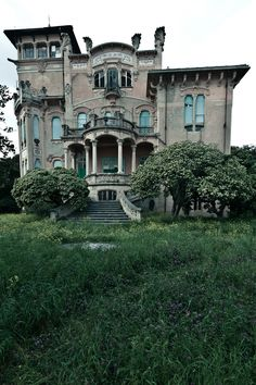 abandoned  house...Its name is Villa Zanelli, its in Italy, and its only abandoned because the whole thing basically collapsed in on itself.