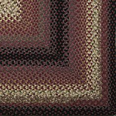 Plumberry-Braided-Rugs-&-Accessories - love the black with the purple...