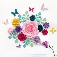 Nuestra cosa favorita acerca de este conjunto de flores de papel es que usted puede utilizarlo para cualquier ocasión: bebé ducha, fiesta de cumpleaños, decoración de la habitación del bebé etcetera. La mezcla de colores es tan brillante e icónico. Y lo mejor de todo, si decorar la