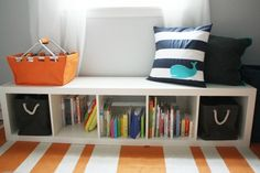 another ikea expedit shelf used as a bench. cute color combo - orange, navy and aqua
