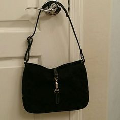 """Coach Small Tote Black fabric small tote. No rips, stains or fading. Clap in front to close. Zipper pocket inside. Black interior. I am 5'7"""" and the bottom of the bag hits below my ribs when on my shoulder. Coach Bags Totes"""