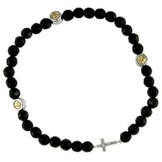 hands down, the cutest cross bracelet, stacked, of course.
