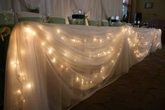 Head table, but with burgundy in front of the lights and table decor that matches all the other tables (burlap, tree stubs, flowers? Wedding 2015, Spring Wedding, Our Wedding, Dream Wedding, Wedding Table, Rustic Wedding, Wedding Reception, Wedding Bells, Reception Table