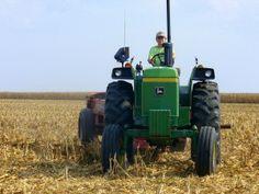 farm kid on john deere tractor
