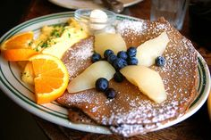 gingerbread pancakes with poached pears & blueberries alongside scrambled eggs - great breakfast!