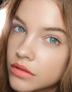 natural dewy skin with brown mascara & coral lipstick.