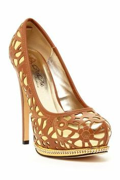 Beautiful cut-out heel with gold.