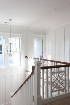 Stairwell Millwork. Upper stairwell millwork. The staircase features batten and board panels painted in Sherwin Williams Extra…
