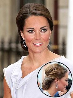 Kate flew solo to a Creative Industries reception in London's Piccadilly to support the Government's GREAT campaign, looking stunning a blue-gray Roksanda Ilincic knee-length number paired with Kiki McDonough drop earrings, perfectly blushed cheeks and her pulled-back 'do.    The low, side chignon was elegant,