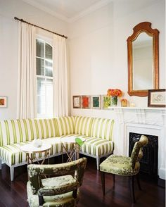 Custom banquettes verging on mini-sectionals are such a great solution for small homes. Could easily build my own!
