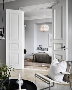 Classic elegance and Nordic minimalism paired in this living room and bedroom - - Classic elegance and Nordic minimalism paired in this living room and bedroom. Classic elegance and Nordic minimalism paired in this living room and bedroom. Home Bedroom Interior Barn Doors, Home Interior, Apartment Interior, Double Doors Interior, Parisian Apartment, French Apartment, Apartment Door, Dream Apartment, Bedroom Apartment
