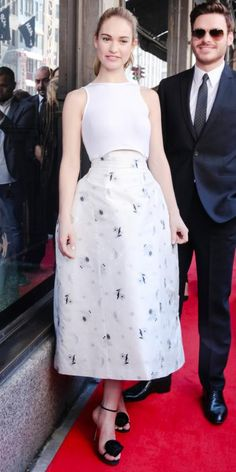 James ruled the red carpet at the Saks Fifth Avenue and Disney Cinderella-inspired designer shoe unveiling in an off-white jacquard silk-and-white cotton Dior frock with black Dior sandals.