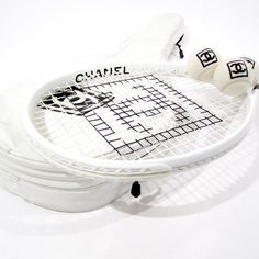 WHAT?! A Chanel tennis racket? This is a little too much, but it is pretty.