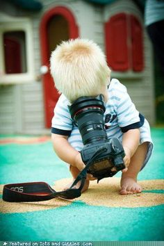 Future photographer...hopefully he will figure out how to use the camera properly....maybe..?
