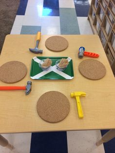 Noach-toothpicks and hammers on cork boards!